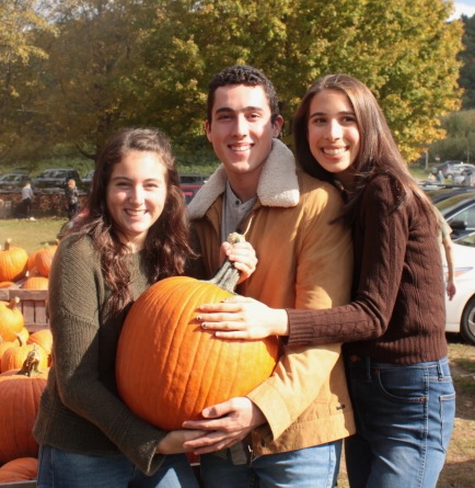 3 students with pumpkin